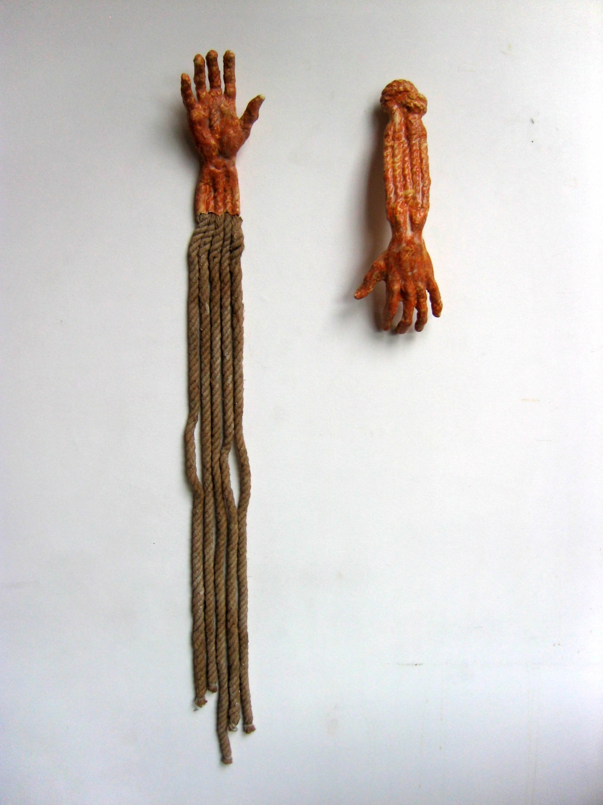 Hands II, 2007, ceramic and rope, 45 cm x 17 cm x 10 cm and 140 cm x 16 cm x 5 cm