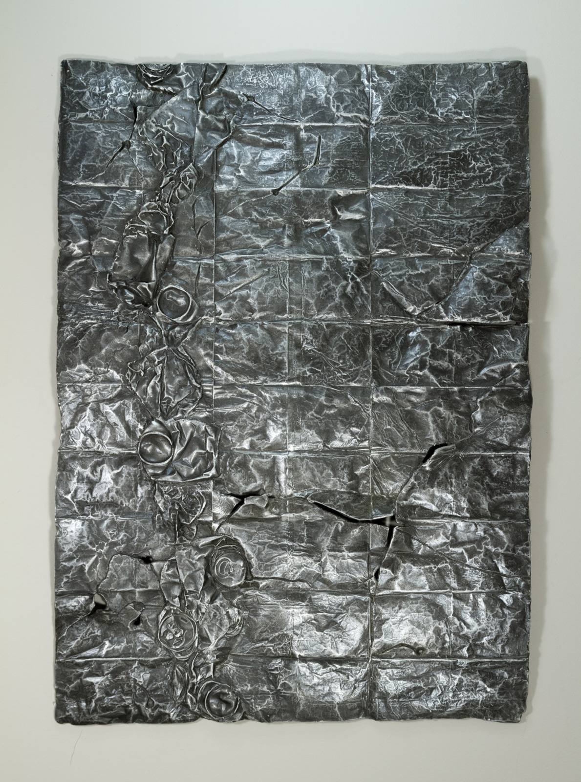 Simandou Mountain Range, Guinea, aluminum sculpture, 71 cm x 91cm x 2 cm, 2013-4. Guineau is the top exporter of Bauxite ore. Mining right to the Simandou mountain range were sold for several billions of dollars following bribes by the firm BSGR to the ex-president's ex-wives.