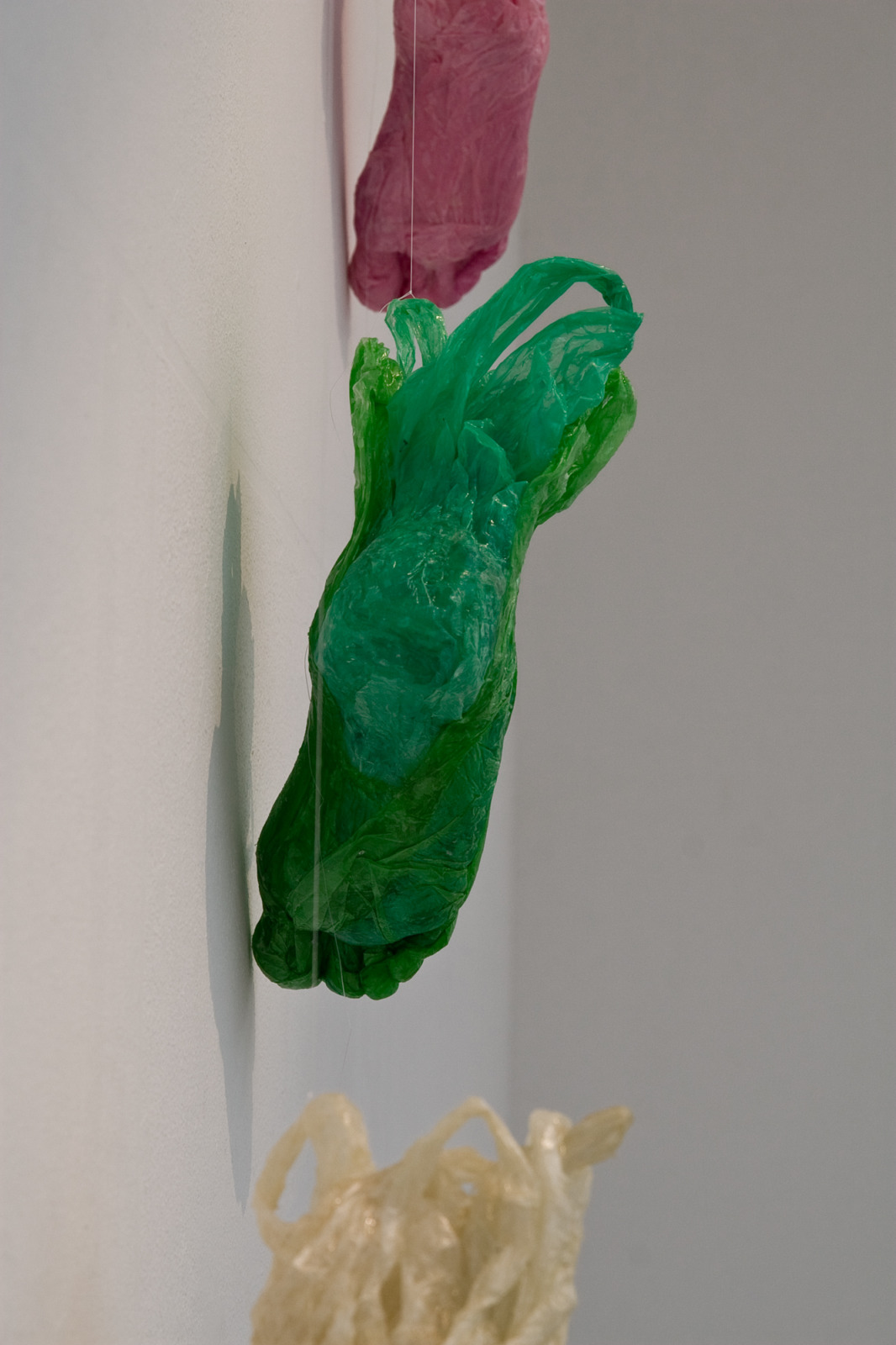 Feet (Flavor of the Month), cast resin with colored plastic shopping bags, 2008-2014, 10 cm x 27 cm x 20 cm (8 elements possible).
