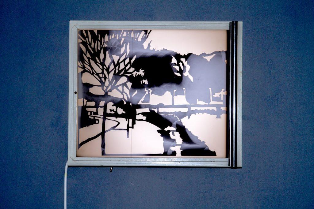 """Frontière interne II 43°20'36.5""""N 1°45'57.1""""W, découpage des radiographies de poumons, 43cm x 35,5 cm, installation sur négatoscope, Centre Culturel Saint Exupéry, Reims, France."""