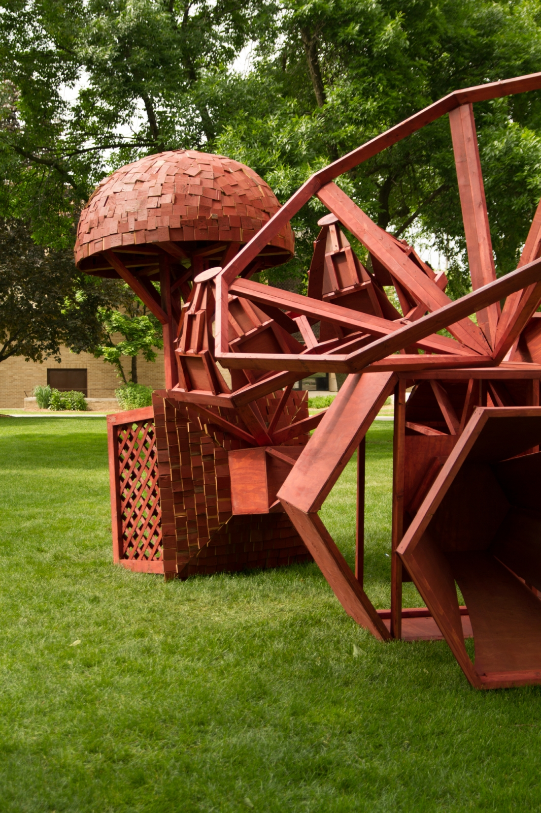Kasia Ozga, Spring Loaded, 2015, Pine, Plywood, Cedar Barnwood, 19 ft. wide x 17 ft. across x 11 ft. high. Carroll University Community sculpture commission sponsored by the Greater Milwaukee Foundation's Mary L. Nohl Fund