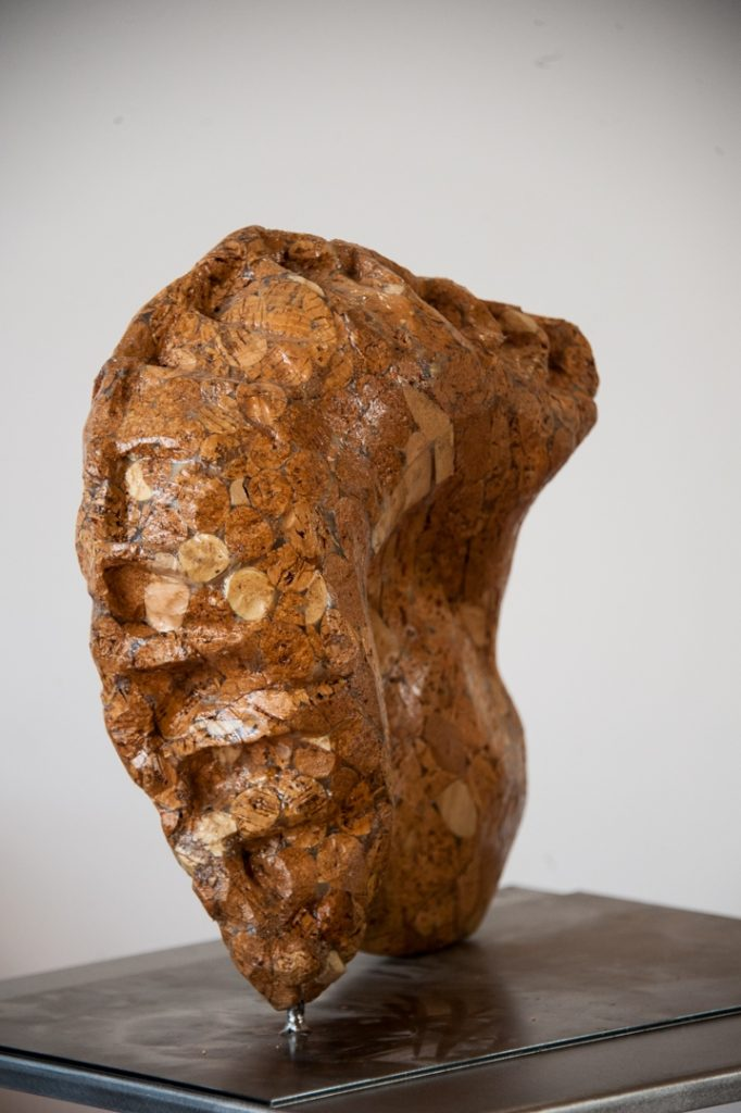 Mouth to Mouth, found real and synthetic wine corks, wood glue, wood varnish, steel base, 2014.