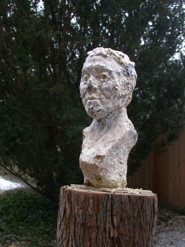 Bite Me, installation, portrait bust cast from birdseed and beef suet, duration: 2 weeks, 2005.