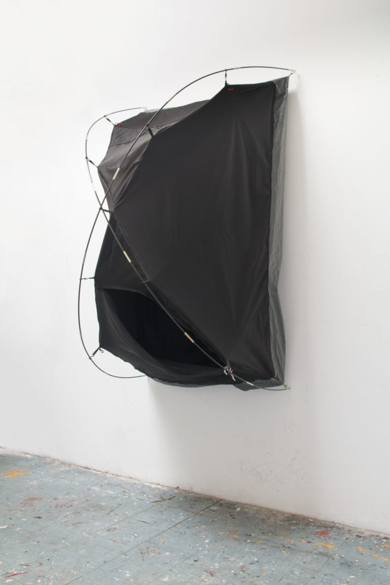 Kasia Ozga, Soft sculpture sewn from blackout fabric, black string, tent poles, tarp. (2019)